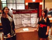 APBS 2014 Student Poster Award winners Lauren Evanovich and Lindsay Hughes standing in front of their poster